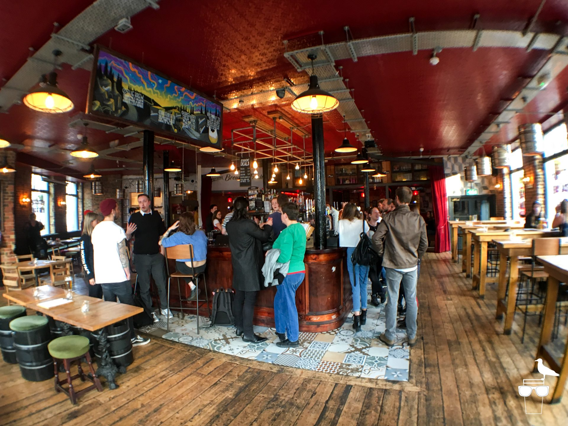 the hare and hounds pub brighton inside people standing at the bar searving area