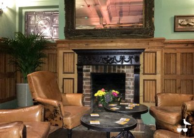 The Dyke Alehouse inside armchairs and fireplace