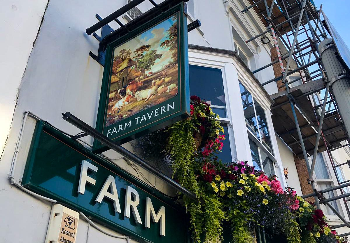 the farm tavern pub hove outside view of pub sign