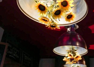 The Gladstone pub London Road Brighton sunflowers hanging upside down in lampshade