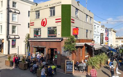 the western pub brighton outside people sitting in the sunshine