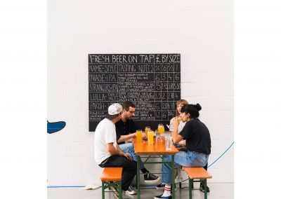beak brewery group sat at table