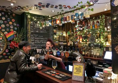 idle hands pub tapbar brighton inside bar and taps barmaid serving customer