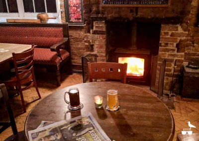 the exchange hove pub inside table fireplace beers