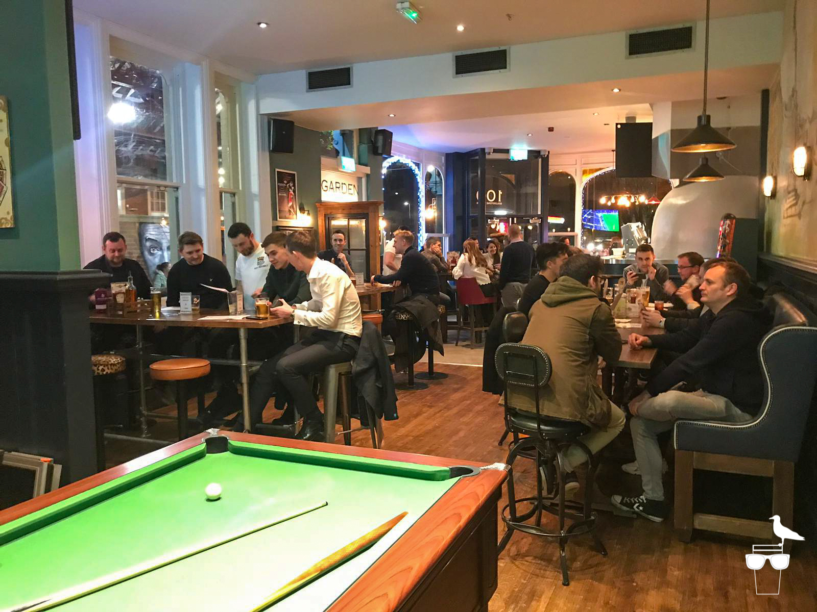 the station pub hove inside view of pool table and busy tables