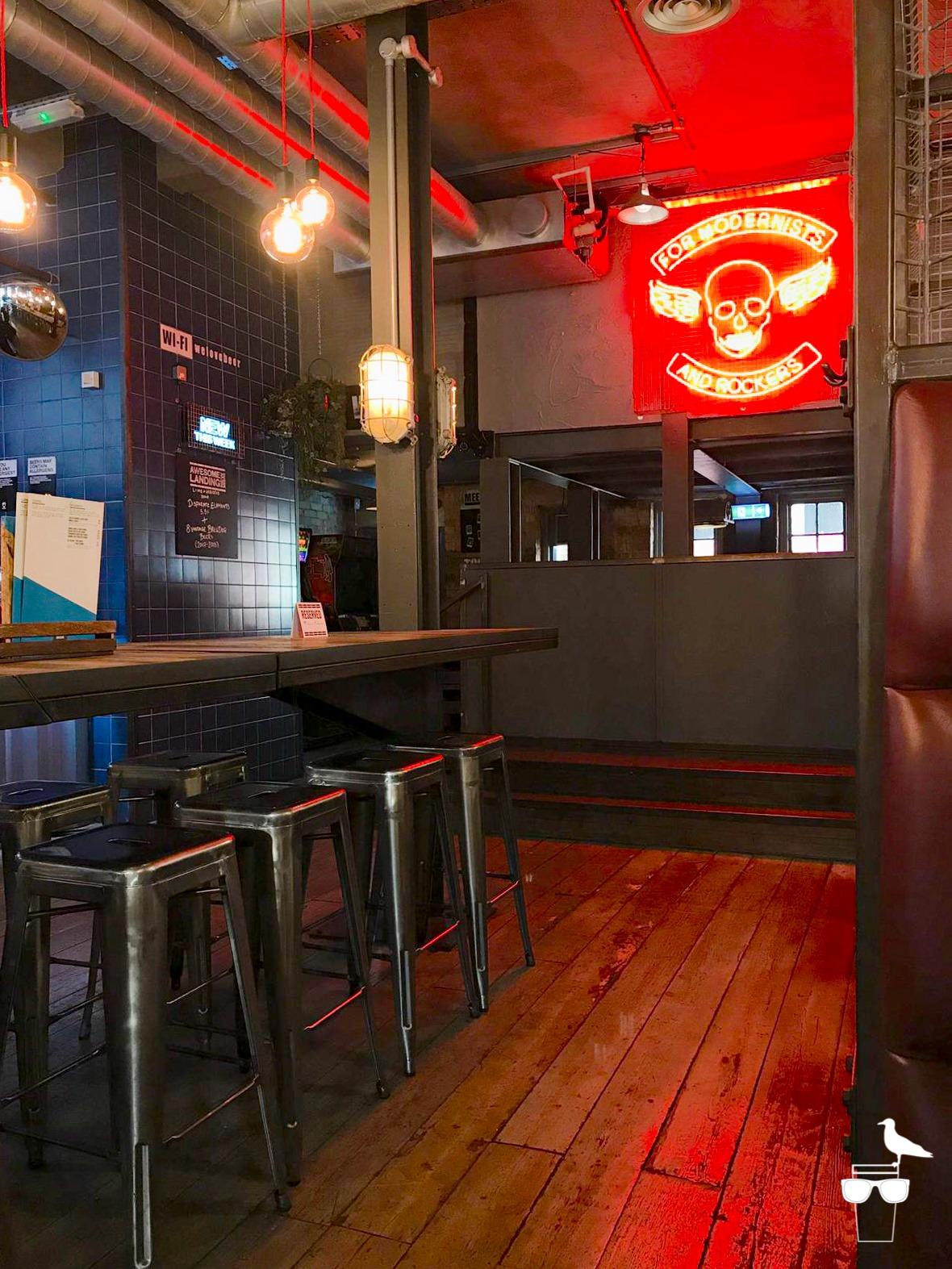 brewdog brighton stools and neon sign