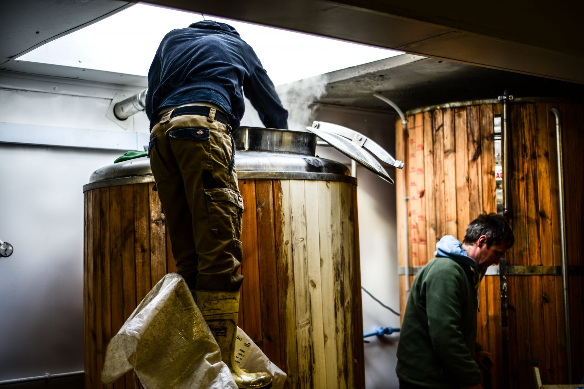 franklins brewery brewer standing over tank