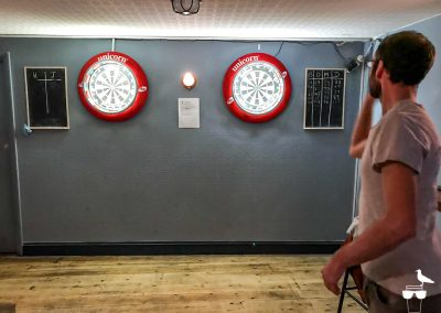 freehaus pub brighton man playing darts