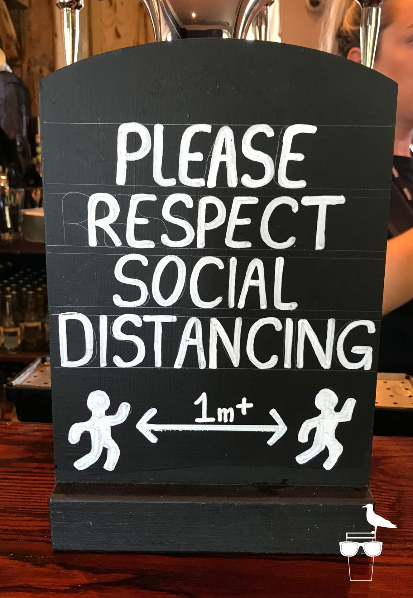 please-respect-social-distancing-bar-sign