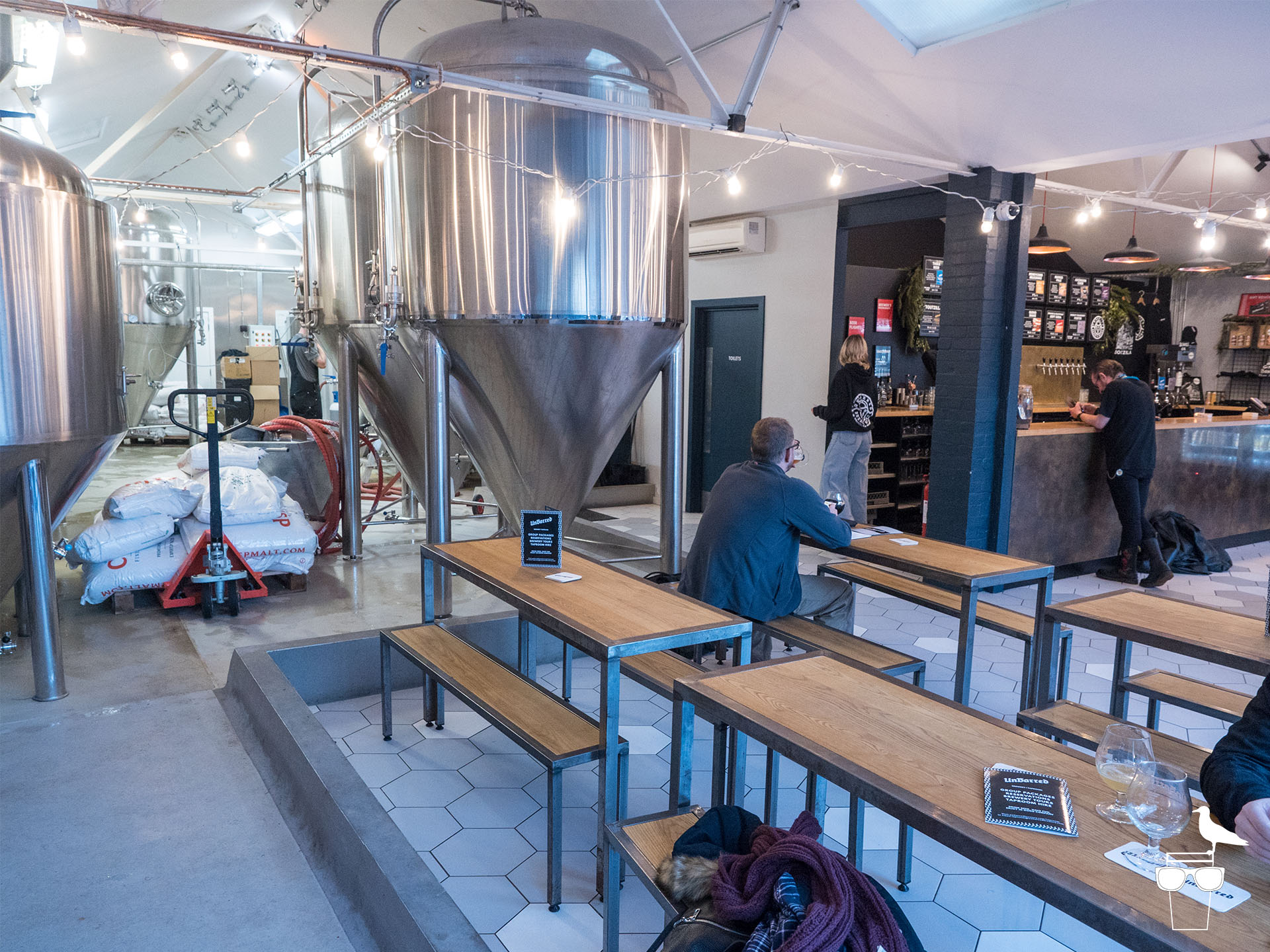 unbarred brewery and taproom brighton inside benches and tanks