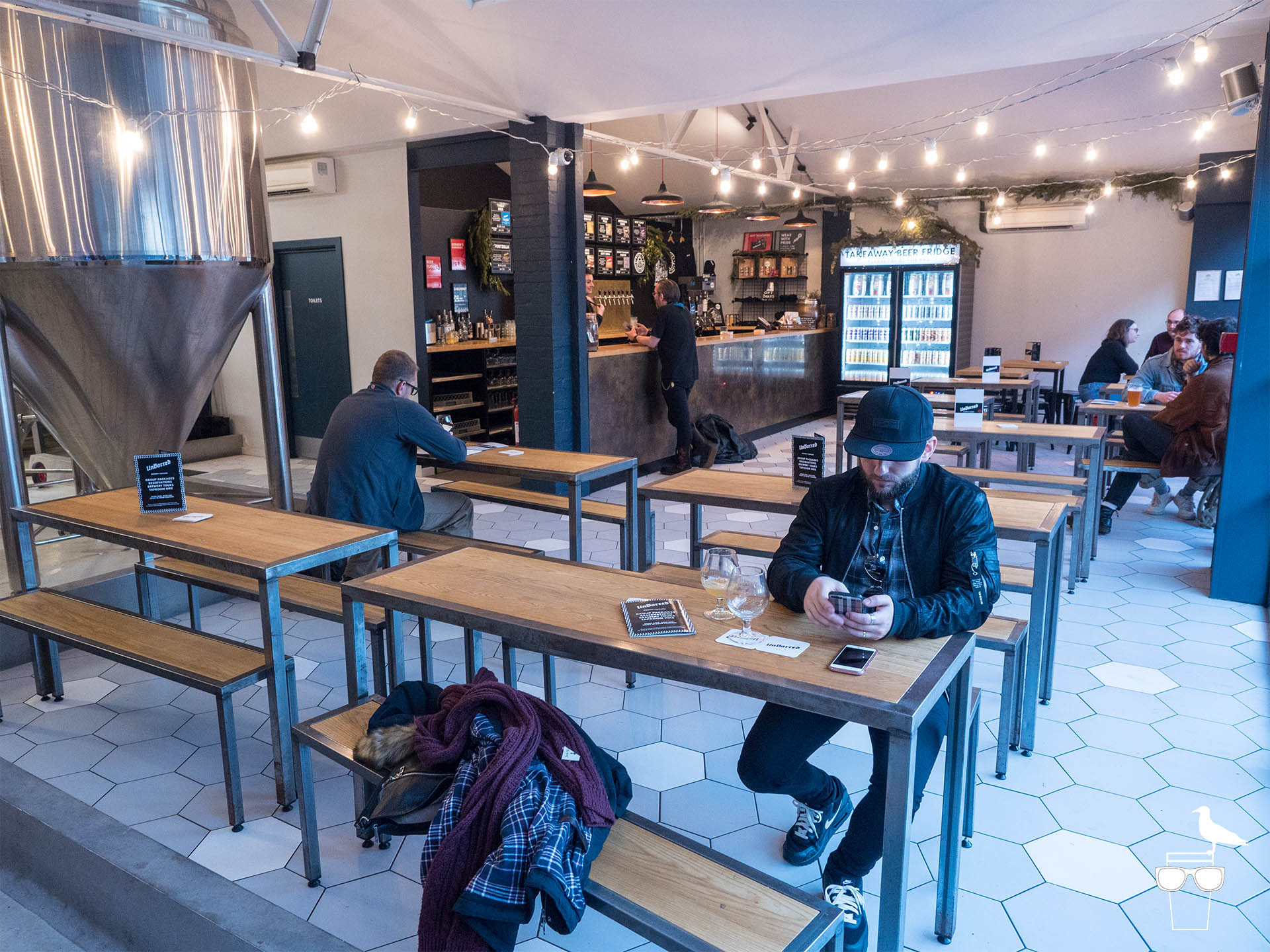 unbarred brewery and taproom brighton inside benches and customers